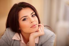 closeup portrait of a young beautiful confident woman - stock photo