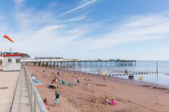 Holidaymakers Teignmouth beach Devon England UK - stock photo
