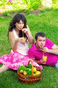 happy young couple having a picnic outdoor on a summer - stock photo