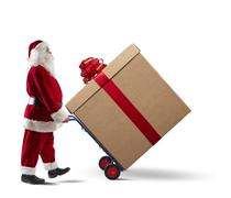 santa claus with big christmas present - stock photo