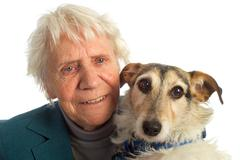 Elderly woman with dog Stock Photos