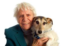 elderly woman with dog - stock photo