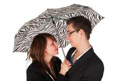 under the umbrella - stock photo