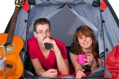 young couple in a tent - stock photo