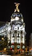 metropolis building in gran via street, in madrid - stock photo