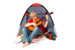 Elderly woman with guitar Stock Photos