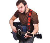 man musician playing his guitar - stock photo