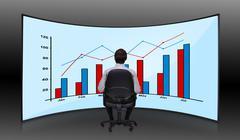 Businessman looking at chart Stock Photos