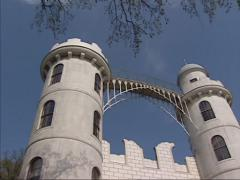 Peacock Island Palace, low angle + pan half-timbered artificial ruin Stock Footage