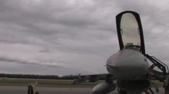 Pilot checking fighter jet at Red Flag Alaska Stock Footage