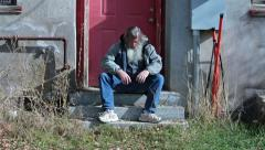 Homeless man sitting behind building sad poor HD 0141 Stock Footage