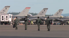 Fighter pilots walk to their aircraft at Red Flag Alaska Stock Footage