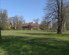 Potsdam New Garden with Cecilienhof Palace + zoom in stained glass window. Stock Footage