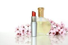 Perfume and Lipstick with Sakura flower Stock Photos