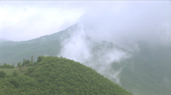 Mists move in  green hills Stock Footage