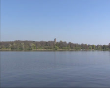 View from Potsdam across lake at Flatow Tower, Babelsberg Park Stock Footage