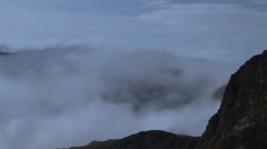 Clouds moving on top of a mountain Stock Footage