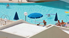 Waterpool area with resting people in Cypriot three stars hotel - stock footage