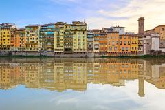 Arno river and buildings architecture landmark on sunset. florence, italy. Stock Photos