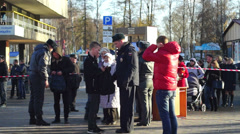 Policemen checking visitors of Sochi2014 Olimpic torch relay in Petrozavodsk Stock Footage