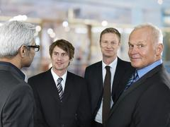 Stock Photo of Portrait of four business men