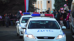 Patrol police cars on Sochi2014 Olympic torch relay in Petrozavodsk Stock Footage