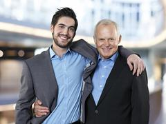 Stock Photo of Portrait of two smiling business men