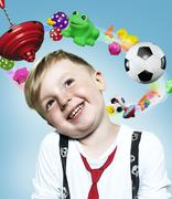Little boy with flying toys around his head, Composite Stock Photos