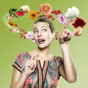 Young woman with flying flowers around her head, Composite - stock photo