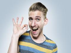 Stock Photo of Portrait of happy young man, studio shot