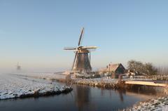 winter windmill landscape in holland - stock photo