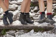 Stock Photo of Italy, South Tyrol, Dolomites, Alta Pusteria, Three women with trekking shoes