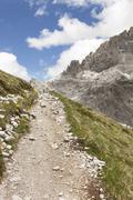 Italy, South Tyrol, Dolomites, Alta Pusteria, Mountainscape with trekking path - stock photo