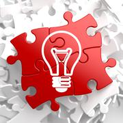 Light Bulb Icon on Red Puzzle. - stock illustration