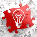 Stock Illustration of Light Bulb Icon on Red Puzzle.