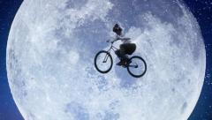Moon bicycle slow motion, male bike flies across night sky, click for HD Stock Footage