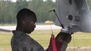 Stock Video Footage of Ground crew maintenance engineer Red Flag Alaska
