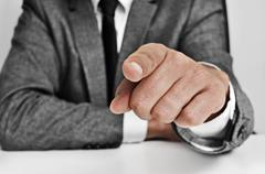 man in suit pointing the finger - stock photo