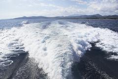 Italy, Sardinia, Wake of yacht Stock Photos