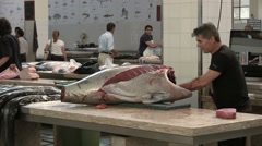 Vendor cuts of tuna, fish market in the Funchal, Madeira, Portugal Stock Footage