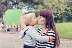 Germany, Bonn, Baby boy kissing mother Stock Photos