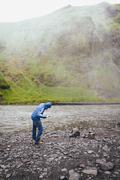 Iceland, Tourist at Skogafoss Waterfall Stock Photos