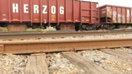 Stock Video Footage of Train Engine Drive by Low Angle Dolly