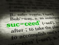Stock Media - Dictionary - Succeed - Green On BG - stock photo