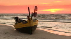 Flags flapping on the boat, Baltic Sea beach - stock footage