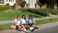 Stock Video Footage of Three Pretty Uniformed Teen School Girls, Waiting On Curb