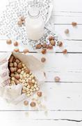 Ingredients for hazel nut milk on wooden table - stock photo