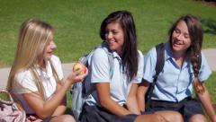 Three Pretty Uniformed Teen School Girls, Sitting & Chatting, One Eats An Apple - stock footage