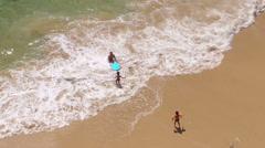 Children play in the sea, beach near Alvor, Algarve, Portugal Stock Footage