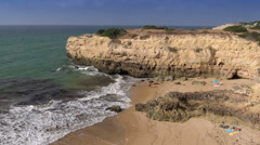 The rocky beach near Armacao de Pera village, Algarve, Portugal Stock Footage